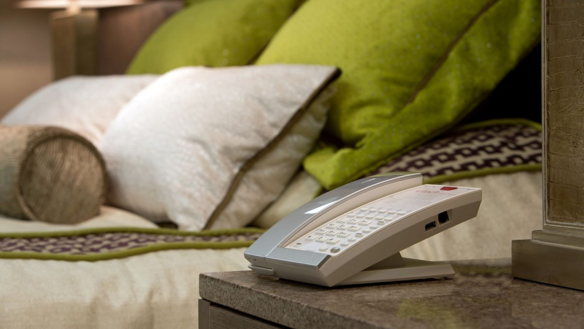 Stylish phone in contemporary hotel bedroom
