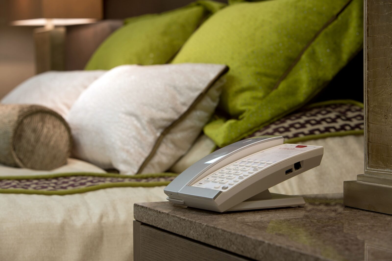 VTech SIP Hotel Phone with new three year warranty in a stylish hotel room.